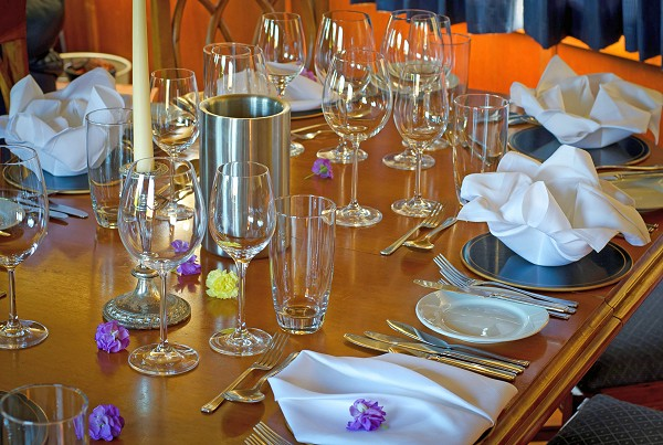 The lovely dining room aboard the Magna Carta is always beautifully set for every meal