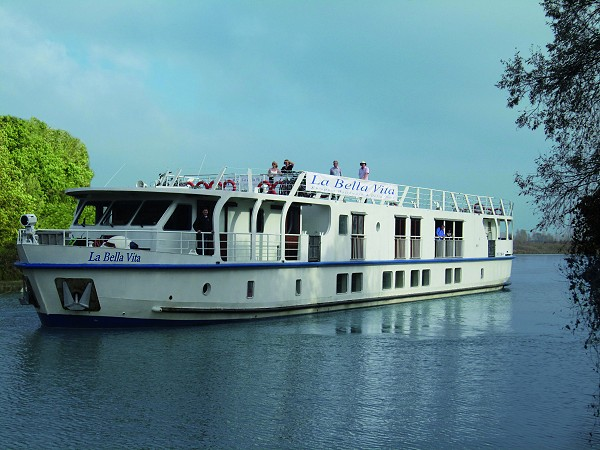 The 20-passenger First Class hotel barge, La Bella Vita cruising on the Bianco Canal,<br> between Venice and Mantua