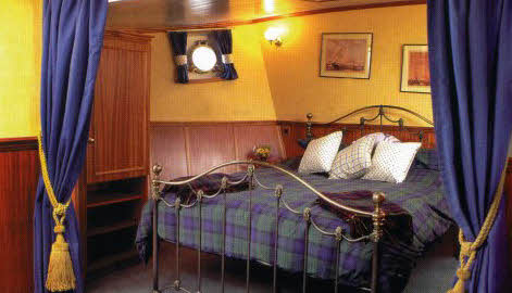 The Cameron Suite, at the bow, spans the entire width of the Scottish Highlander.